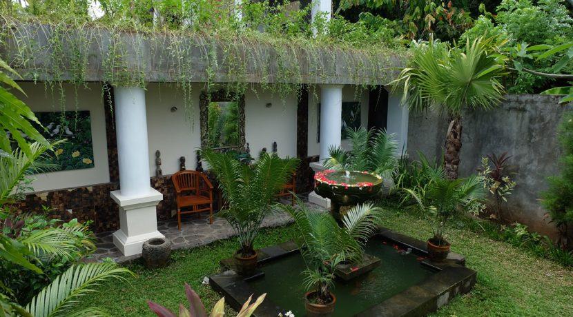 lovina-hillside-villa-for-sale-bedroom-garden-1